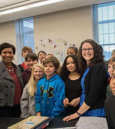 Mayor Bowser posing with a class